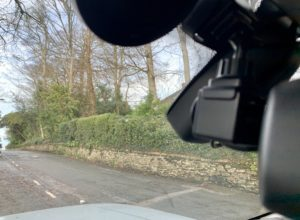 Dash cam fitted on windscreen with clear vision on the road ahead